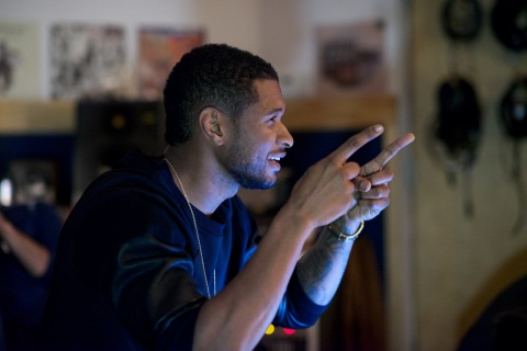 Global superstar and eight-time Grammy Award- winning artist, Usher is set to curate the concept, score and design of the 37th annual Macy's 4th of July Fireworks. Usher is seen here during a creative meeting with the Macy's Fireworks team on Feb. 17, 2013. Photo credit: Kent Miller/Macy's, Inc.