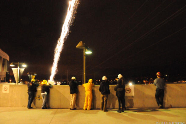 The pyro crew watches the first shells fire high into the sky. (Credit: Daniel Terdiman/CNET)