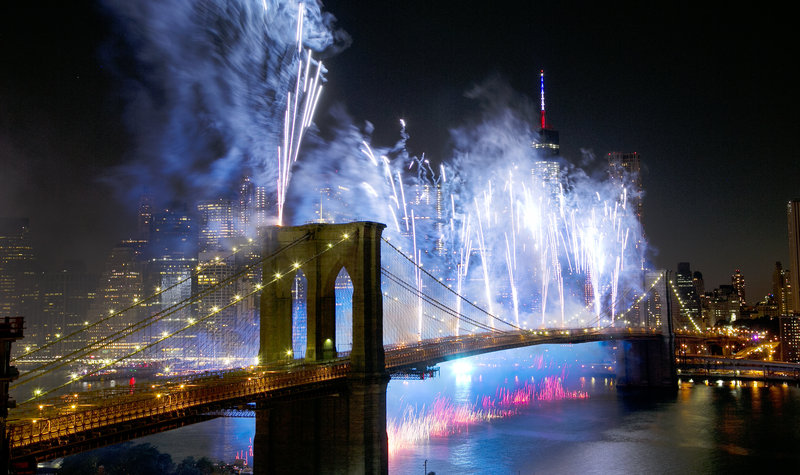 Fireworks light up the sky above the Brooklyn Bridge during Macy's 4th of July Fireworks Spectacular in 2014. Mark Lennihan/AP