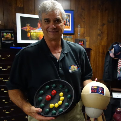 Jim Souza, president of Pyro Spectaculars, poses with samples of some of the fireworks he's planning for this year's Macy's show. (James Delahoussaye/NPR)