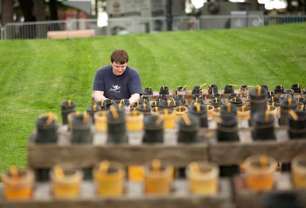 Bradley Blaylock, a first-year volunteer with Pyro Spectauclar, helps prepare fireworks at Riverfront Park's Havermale Point on Tuesday, July 3, 2018. Wednesday's show will feature about 280 cues to detonate, with two or more fireworks per cue that will go off. (Libby Kamrowski / The Spokesman-Review)