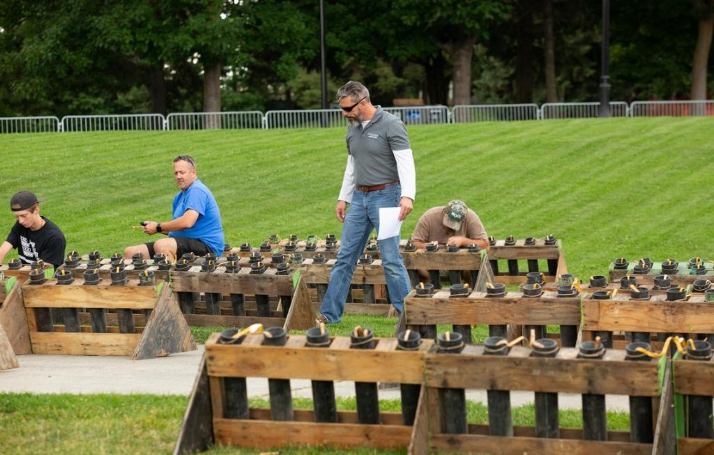 Matt King, Pyro Spectaculars' supervisor for Spokane's annual Fourth of July fireworks show, inspects rows of fireworks on Tuesday, July 3, 2018, in Riverfront Park. The fireworks will detonate from Havermale Point. (Libby Kamrowski / The Spokesman-Review)