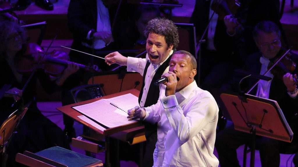"Chris Martin sings the Beach Boys' ""Good Vibrations"" while Gustavo Dudamel conducts the Los Angeles Philharmonic to conclude the ""California Soul"" opening night gala concert. (Luis Sinco / Los Angeles Times)"