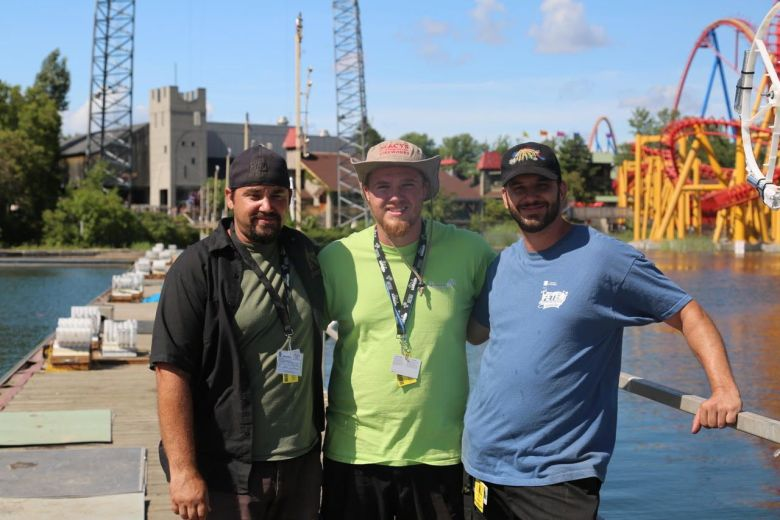 Souza brothers, from left, Christopher, Richard and Paul, at the firing site in La Ronde, Montreal, location of the international fireworks competition. (Courtesy photo)