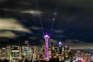 Lights shine from the Space Needle, celebrating the new decade a few minutes after midnight in this view from Kerry Park in Seattle on Jan. 1, 2020. (Andy Bao / The Seattle Times)