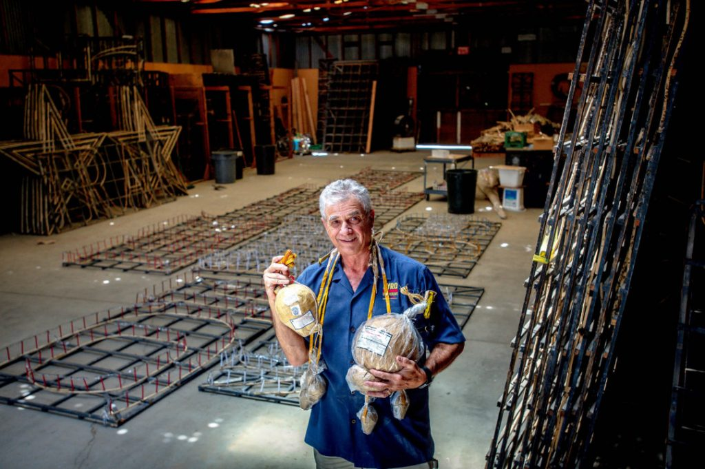 Pyro Spectaculars CEO Jim Souza holds different types of aerial firework shells inside a firework assembly building in Rialto on Thursday, June 17, 2021. (Photo by Watchara Phomicinda, The Press-Enterprise/SCNG)