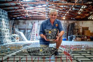 Pyro Spectaculars CEO Jim Souza shows different types of aerial firework shells inside a firework assembly building in Rialto on Thursday, June 17, 2021. (Photo by Watchara Phomicinda, The Press-Enterprise/SCNG)